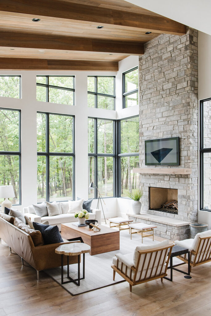 Studio Mcgee living room, large windows, stone fire place with tv