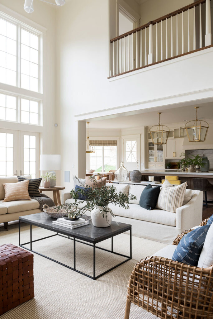 Studio Mcgee living room, vaulted ceilings, white couch, fireplace with built ins