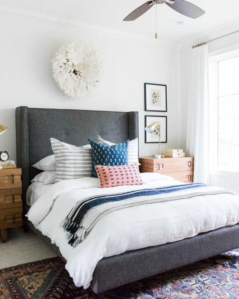 Studio McGee by Bedrooms: Austin Texas Project; dark grey bed; upholstered bed