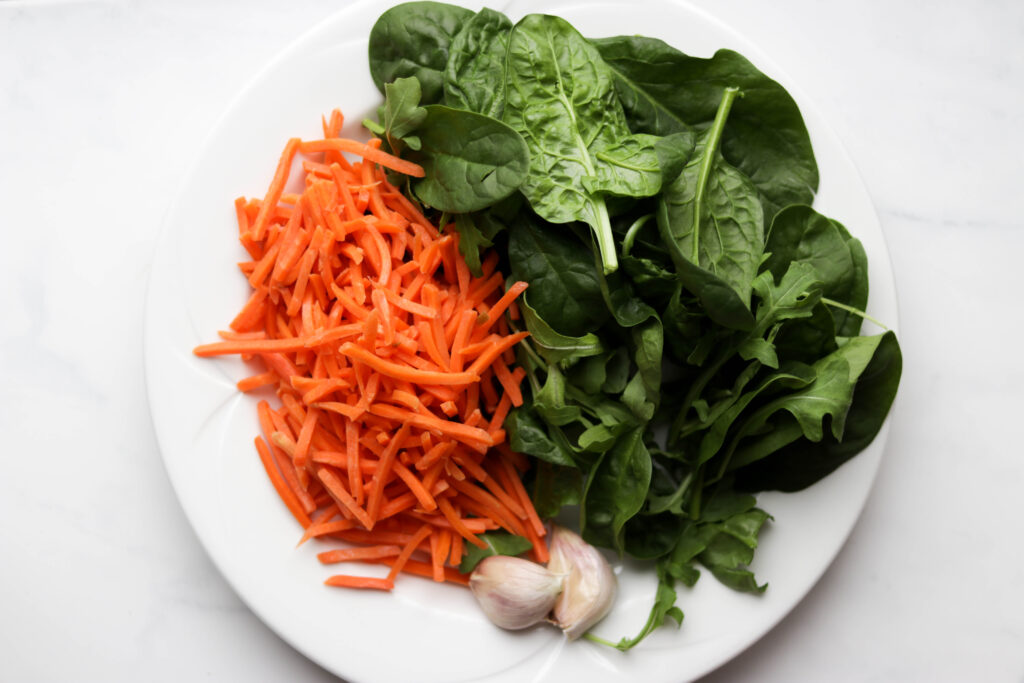 plate of carrot, spinach and garlic