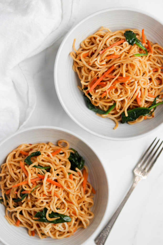 This Easy Vegan Noodle Stir Fry is made with fresh vegetables, Tamari sauce, garlic, and spiced up with optional Sriracha sauce. This healthy dish can be made in less then 30 minutes! #veganstirfry