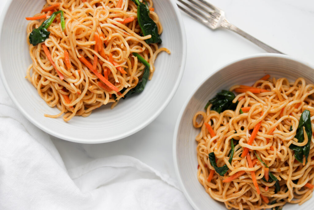 Easy Vegan Noodle Stir Fry is made with fresh vegetables, Tamari sauce, garlic, and spiced up with optional Sriracha sauce. This healthy dish can be made in less then 30 minutes!