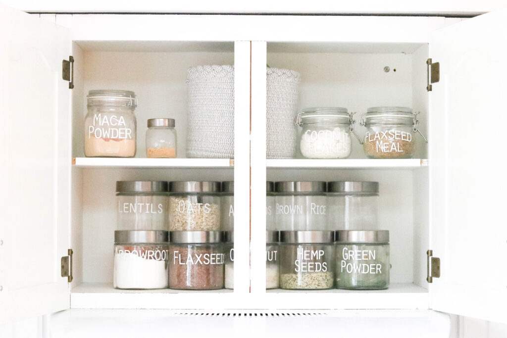 Pantry Organization with Large Labels; after photo organized pantry, clear jar, small jar, silver lid