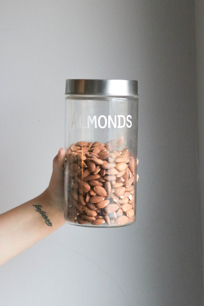 Pantry Organization with Large Labels;  almonds, clear jar, small jar, silver lid