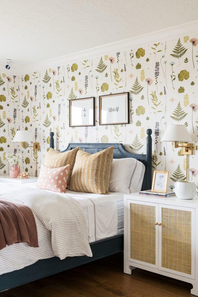 Studio McGee by Bedrooms: Northridge Remodel; Floral wall paper, dark blue bed, antique bedroom