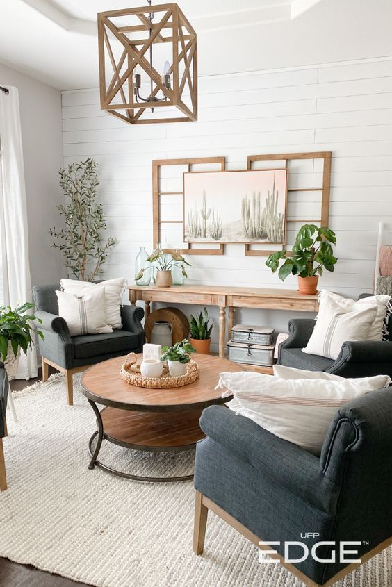 FarmHouse Living Room on a Budget; room with greenery and plants, shiplap wall