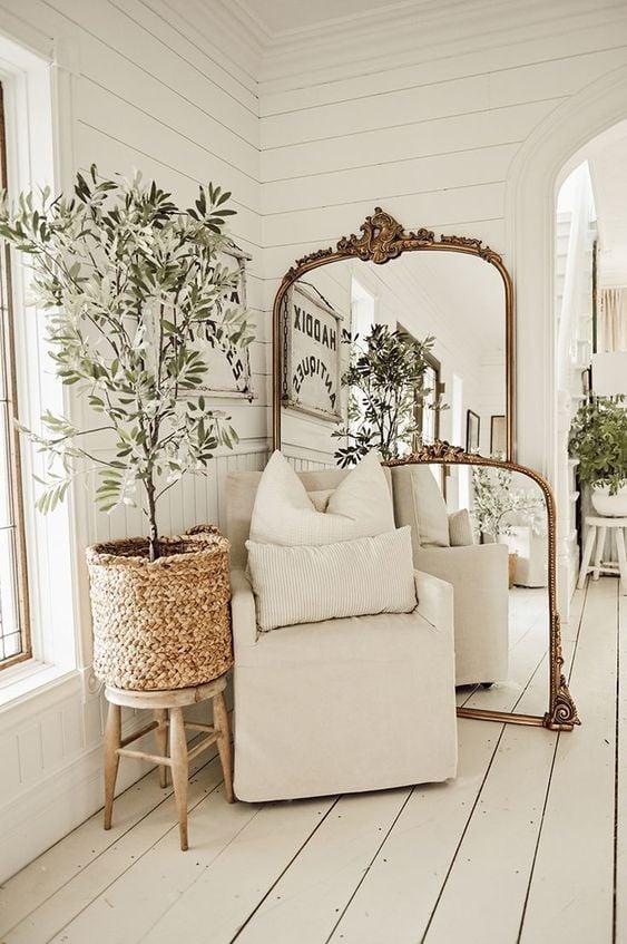 Antique mirror against wall, gold frame; Farmhouse Wall Decor Ideas