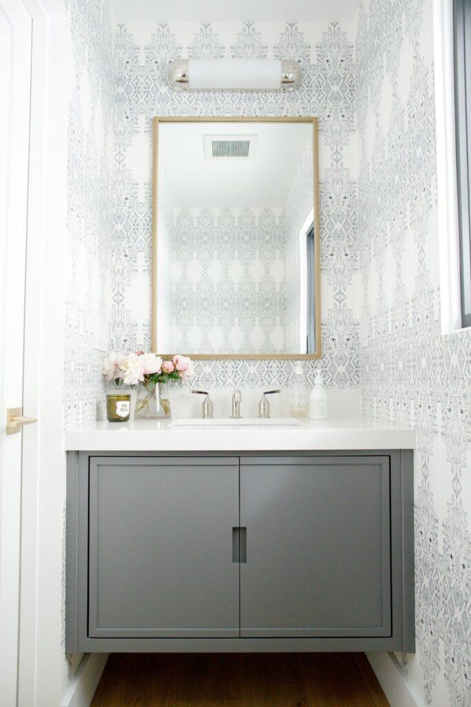 Bathrooms by Studio McGee; grey vanity, white counter top, wallpaper, small bathroom, gold mirror