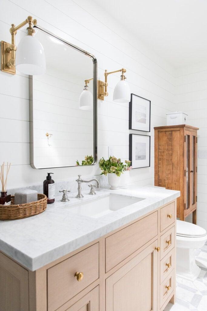 Bathrooms by Studio McGee;  light vanity, oak vanity, pine vanity, antiques, marble counter