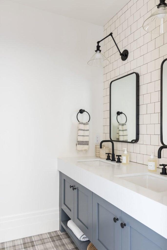 Bathrooms by Studio McGee; grey vanity, black accents, square black mirror, subway tile