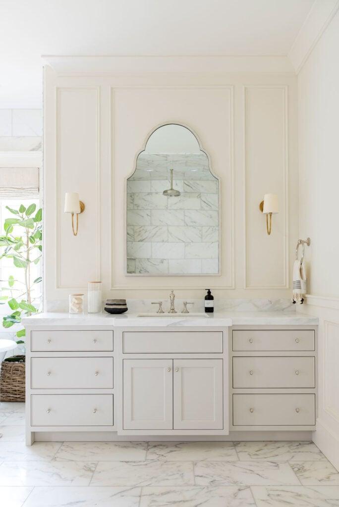 Bathrooms by Studio McGee; elegant bathroom, luxury bathroom, marble, large vanity, cream vanity