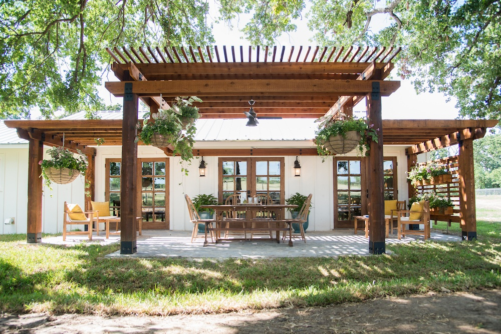 wood pergola - Top Outdoor Spaces by Joanna Gaines; best backyard, garden and patio areas redone by Joanna Gaines from Fixer Upper