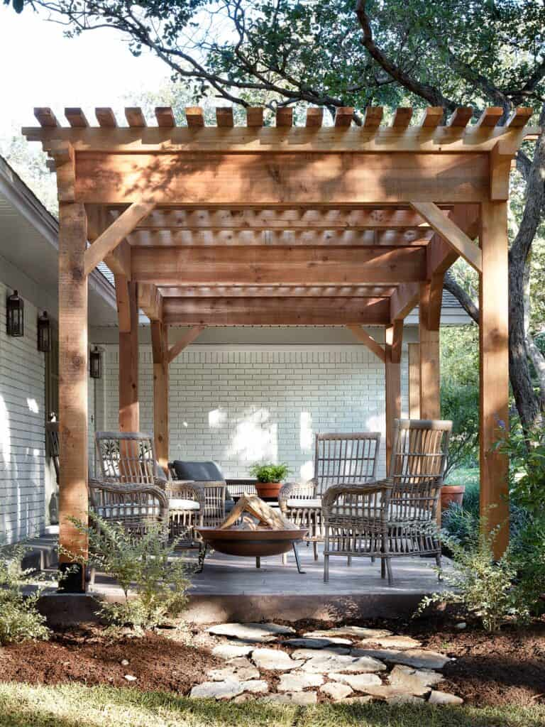 wood Pergola, wicker outdoor furniture - Top Outdoor Spaces by Joanna Gaines; best backyard, garden and patio areas redone by Joanna Gaines from Fixer Upper