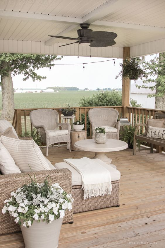 Tips for Styling your Deck this Summer; deck greenery, plants on deck, beige deck, beige outdoor furniture