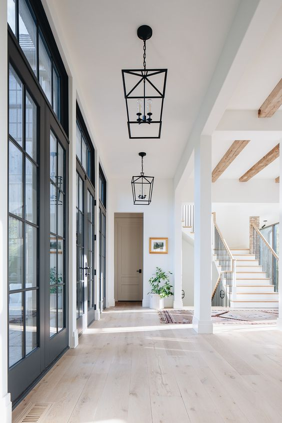Modern Farmhouse Design Must haves: large windows, open concept, white, bright, chandelier