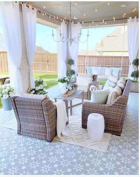 Tips for Styling your Deck this Summer; cozy patio, outdoor pillows, outdoor curtains