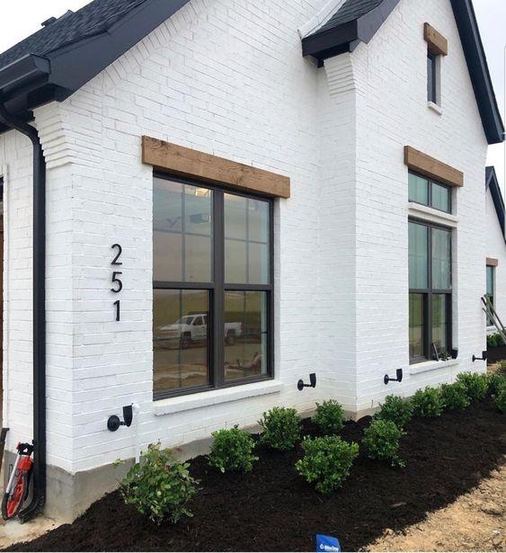 Modern Farmhouse Design Must haves: white brick, painted brick, black trim windows, wood trim