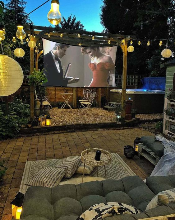 Tips for Styling your Deck this Summer; backyard movie screen, movie night outdoors, outdoor projector