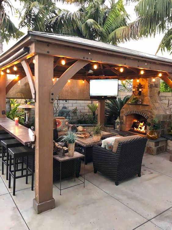 Tips for Styling your Deck this Summer; backyard gazebo idea, string lights, outdoor tv, outdoor fireplace.