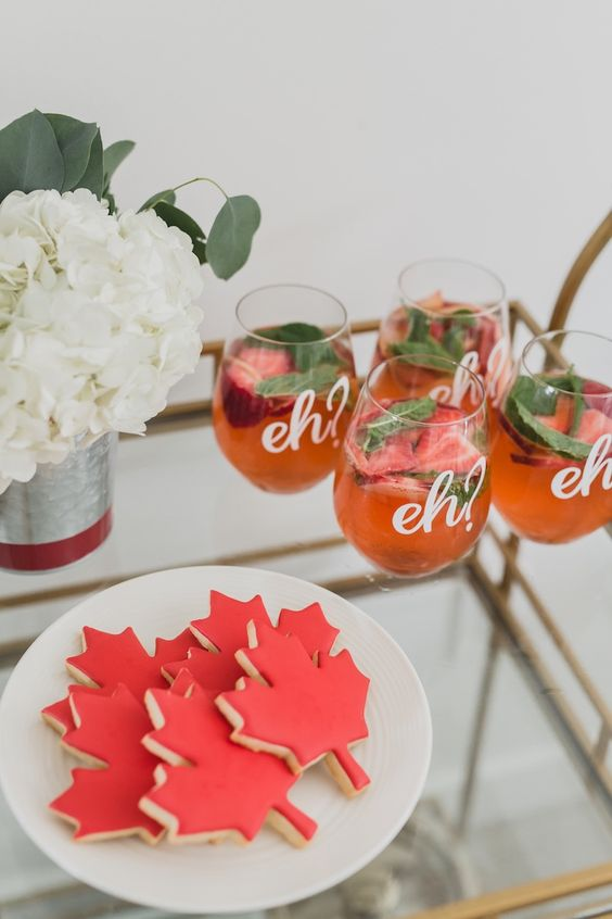 Canada Day Food Ideas: Recipes and Drinks - maple leaf cookies in red, red drinks that say eh on them