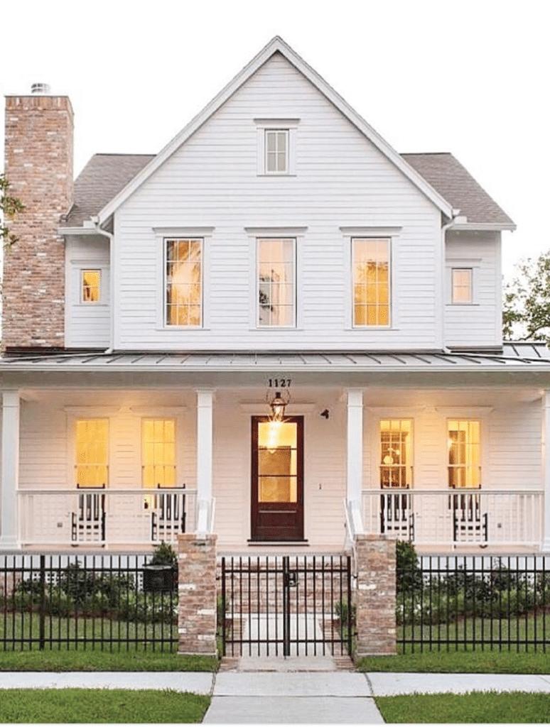 white modern farm house, black trim windows, large front porch, tall windows, symmetrical exterior