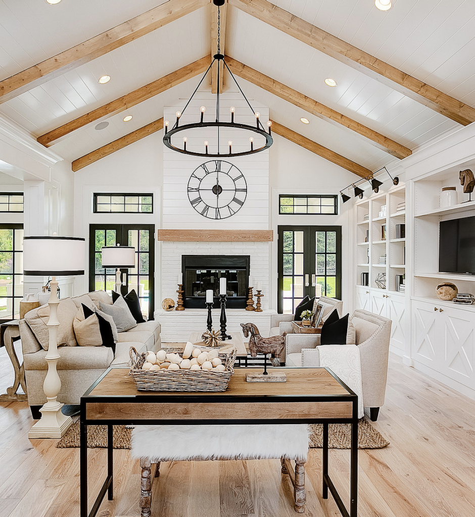 Modern Farmhouse Design Must haves: open concept living room, wood beams, large windows, fire place
