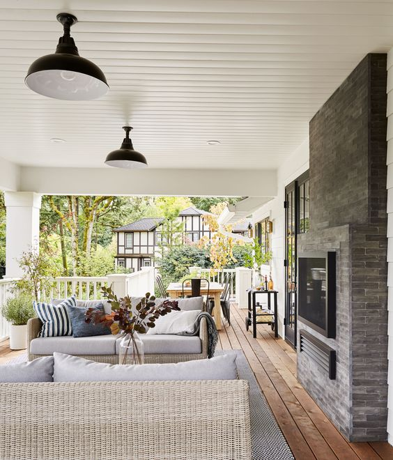 Tips for Styling your Deck this Summer; fireplace, wicker furniture, wicker outdoor furniture, living space