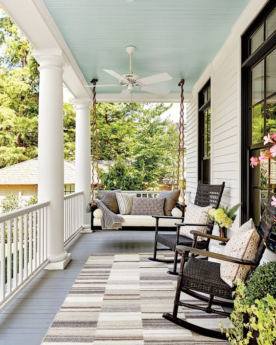 Modern Farmhouse Design Must haves: front porch, swing, sitting area, rocking chairs