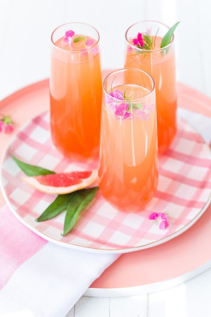 Delicious Summer Cocktail: Citrus Champagne Punch - made with orange and grapefruit juices, simple syrup, and grenadine.