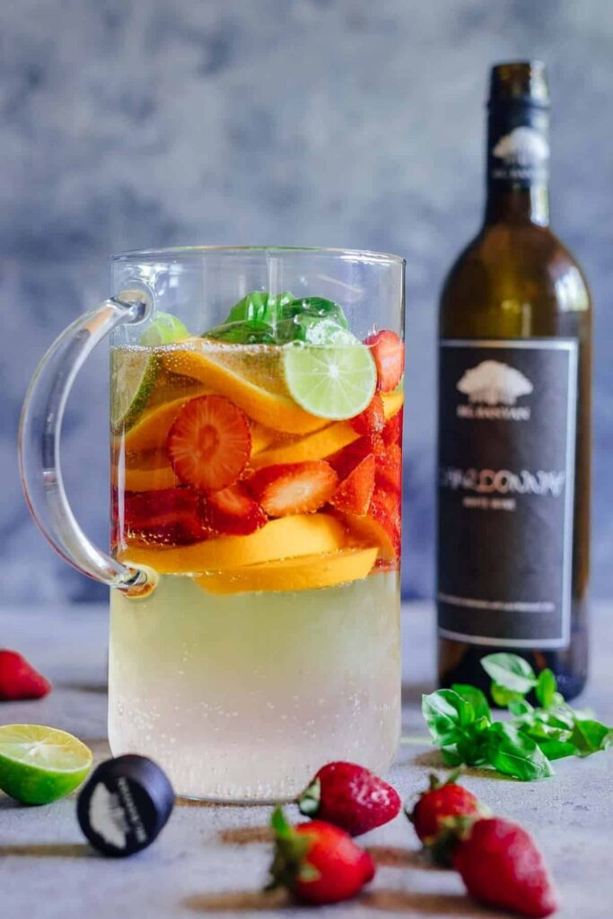Delicious Summer Cocktails: Strawberry Orange White Wine Sangria - strawberries, oranges, lime and basil with white wine
