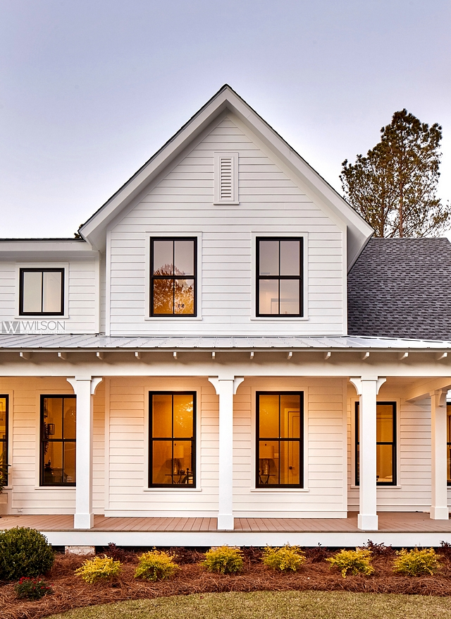 white modern farm house, black trim windows, large front porch