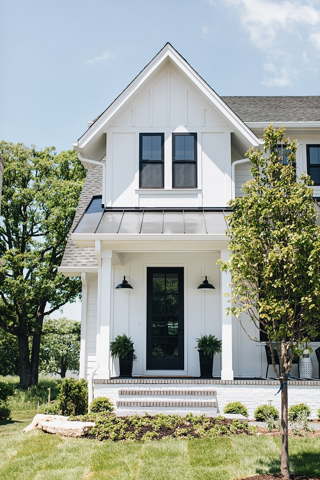 Modern Farmhouse Design Must haves: white siding, black windows, black door, porch, black scones