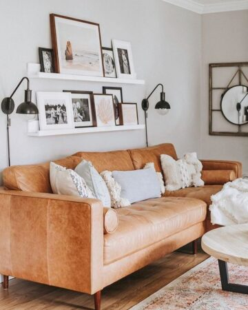Behind Couch Decor Ideas for Your Living Room; floating shelves, leather couch, wall mount lights