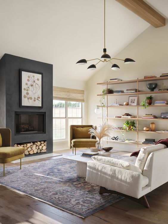 Best NEW Living Rooms by Joanna Gaines from Fixer Upper; dark grey fireplace, shiplap, white couch, shelves