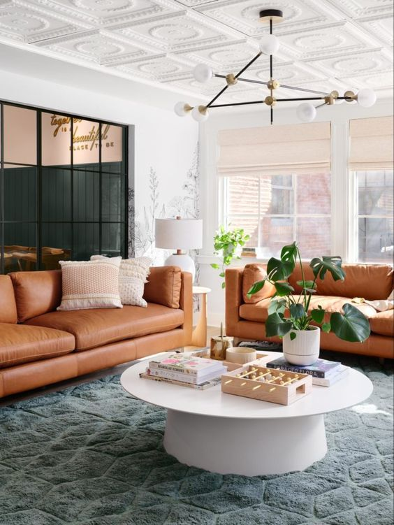 Best NEW Living Rooms by Joanna Gaines from Fixer Upper; leather couch, green, girly, pink, modern farmhouse