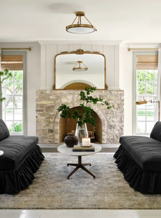 Best NEW Living Rooms by Joanna Gaines from Fixer Upper;  stone fireplace, black couch, anthropologie mirror
