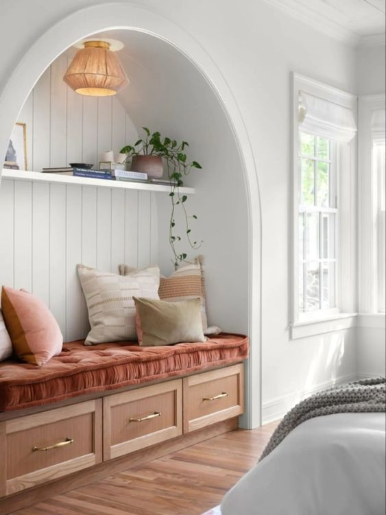 Best NEW Living Rooms by Joanna Gaines from Fixer Upper; reading nook, built in bench with storage in closet area