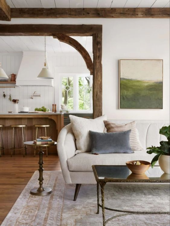 Best NEW Living Rooms by Joanna Gaines from Fixer Upper; wood beams, white couch, farmhouse