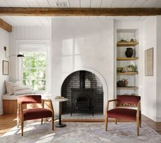 Best NEW Living Rooms by Joanna Gaines from Fixer Upper; brown chairs, wood stove, fireplace, pellet stove, wood beams