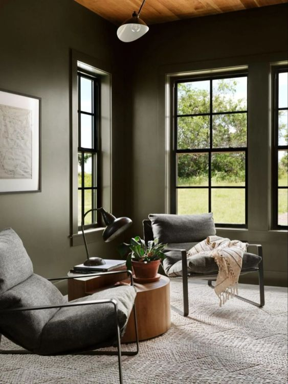 Best NEW Living Rooms by Joanna Gaines from Fixer Upper; moody seating area, dark chairs, reading area