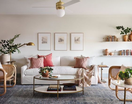 Best NEW Living Rooms by Joanna Gaines from Fixer Upper; blue accents, white couch, farmhouse, vintage