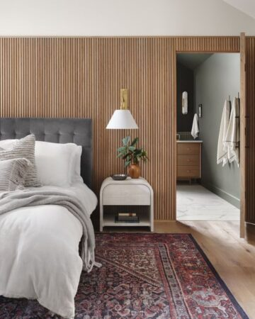 Best NEW bedrooms by Joanna Gaines from Fixer Upper; wood accent wall, gold scones, grey headboard