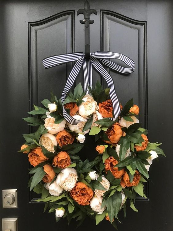 7 Fall Porch Decor Must Haves;  wreath\, orange flowers