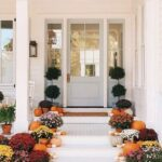 7 Fall Porch Decor Must Haves; blue door, mums, flowers