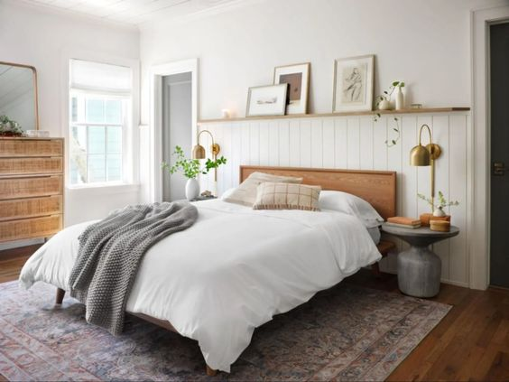 Best NEW bedrooms by Joanna Gaines from Fixer Upper; minimalist bedroom, gallery wall